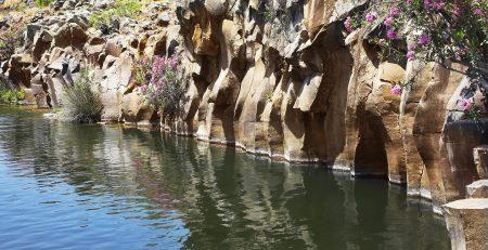 Basalt Rock Surrounding a Reservoir.