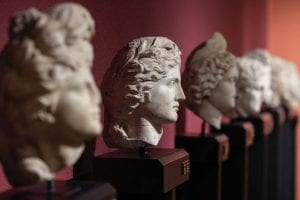 Line of ancient greek busts with center bust in focus